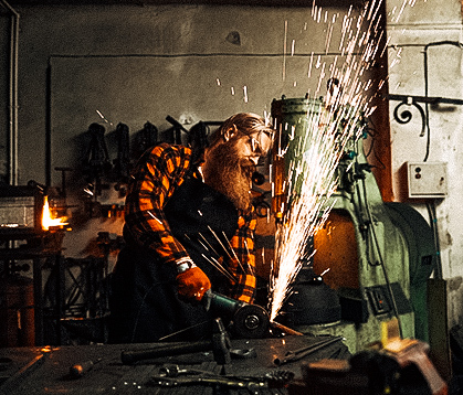Bearded man using grinder