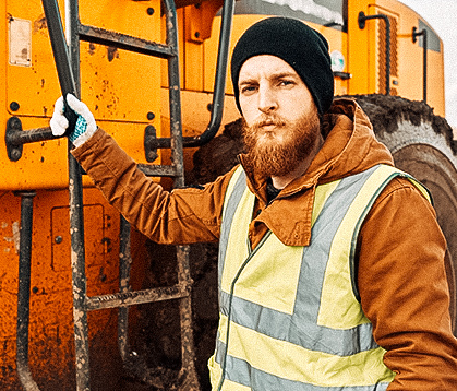 Bearded Gold Miner Posing with Truck